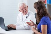 Woman Visiting Experienced Physician