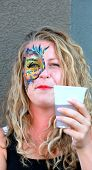 Female face painter.