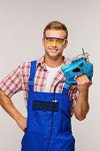 Smiling repairman with tool