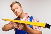 Repairman with builder level