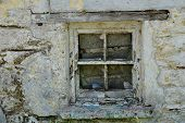 picture of irish moss  - a close up photo of an old style window on the ruins of a traditional irish cottage - JPG