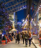 Stratford village square and big shopping centre decorated with Christmas lights and lots of people