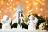 image of christmas angel  - Knitted Christmas angels and Christmas decorations on bright background - JPG