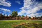 wat Mahathat against blue sky in Sukhothai, Thailand