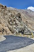 stock photo of manali-leh road  - Desert Mountain Road Turn in Indian Himalaya - JPG