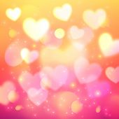 Shining bokeh effect hearts pink background