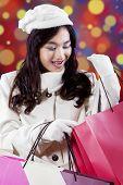 Cheerful Teenage Girl Looking Shopping Bags