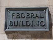 Closeup To A Sign Saying Federal Building