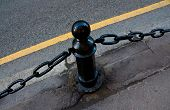 Iron Fence With Chain In The Roadway