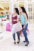Two Asian Women Shopping In Mall