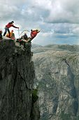 foto of jump rope  - Man jumping off a cliff with a rope - JPG