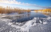 Beautiful Winter Landscape With Frozen Lake, Reeds And Power Plant.