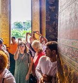 People Visit Lying Buddha In Wat Pho