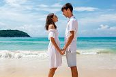 young lovely romantic couple on a beach