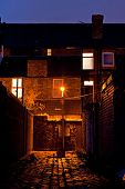 Dark Inner City Cobblestoned Back Alley With Streetlight At Night