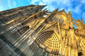 image of koln  - Facade of the Dom church in the city Cologne with blue sky and evening sun - JPG