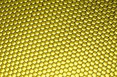 Honeycomb grid against yellow