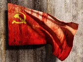 image of communist symbol  - 3d rendering of an old soviet flag on a dirty wall - JPG