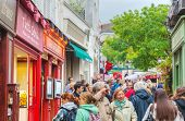 Crowded Street On The Montmartre Hill In Paris