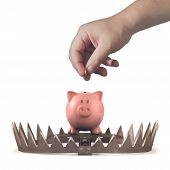 image of trap  - Piggy bank in the bear trap on white background - JPG