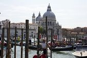 Venice Gondolier In A Traditional Venetian Canal