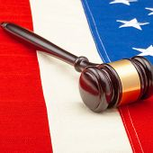 Wooden Judge Gavel Over Us Flag - Closeup Studio Shot