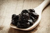 Dried Plums Prunes On Wooden Spoon
