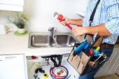 pic of plumber  - Plumber on the kitchen - JPG
