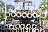 Construction Concrete Root Pole On Lifting Crane Preparing To Construction Site
