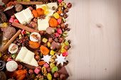 Wood background with sweets and chocolate