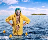 Strange man with face pack stands in water