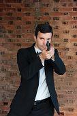 Hitman in tuxedo holding a gun