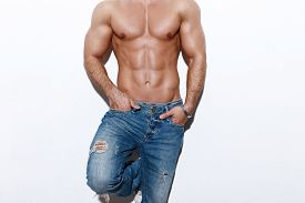 picture of macho man  - Sexy muscular man body posing at white wall - JPG