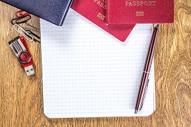 foto of passport template  - Opened notebook on blank page on wooden desktop background - JPG