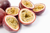 stock photo of passion fruit  - Passion Fruit cut in half over a white background - JPG