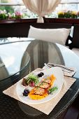 picture of patty-cake  - White meat patty cakes with pumpkin on restaurant table - JPG