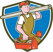 foto of overalls  - Illustration of a plumber in overalls and hat holding pipe on shoulder and carrying toolbox viewed from the side set inside shield crest on isolated background done in cartoon style - JPG