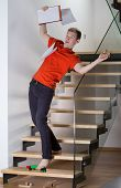 foto of blind man  - Young inattentive man slipping on stairs on a toy - JPG