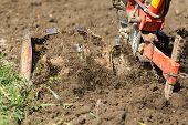 foto of plow  - Closeup of hand motor plow blade throwing clay - JPG