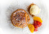 picture of cream puff  - Apple pie in puff pastry served with ice cream and candied fruit - JPG