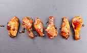foto of chicken  - spicy and delicious hot chicken wings in a row - JPG