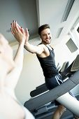 foto of treadmill  - Young man training on a treadmill in the gym - JPG