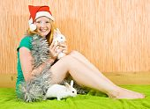 picture of tawdry  - teen girl in peddlery with two pet rabbits - JPG