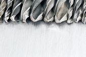 image of drill bit  - Drill bits on scratched metal background macro view - JPG