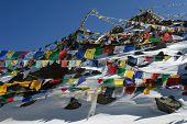 image of karakoram  - Buddhist prayer flags next to the high mountain pass Khardung La in Himalayas - JPG
