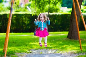 picture of playground school  - Little boy and girl on a playground - JPG