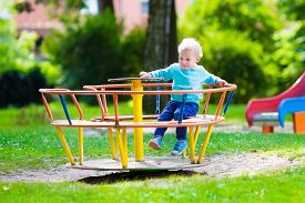 image of daycare  - Little boy on a playground - JPG