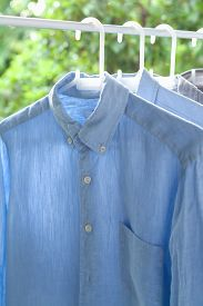 foto of apparel  - ironing concept housework ironed folded shirts clean still life garment apparel - JPG