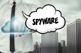 picture of spyware  - Spyware text on cloud computing theme with businessman on cityscape background - JPG