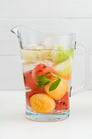 image of honeydew melon  - Infused water with watermelon Galia melon honeydew and mint in a pitcher - JPG